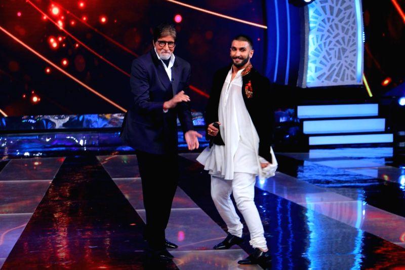 Actors Amitabh Bachchan and Ranveer Singh shake a leg during the former`s show Aaj Ki Raat Hai Zindagi in Mumbai on Nov 27, 2015. - Ranveer Singh