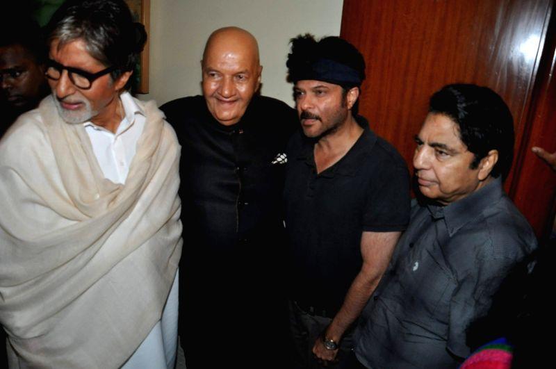 Actors Amitabh Bachchan, Prem Chopra and Anil Kapoor during the launch of Prem Chopra's autobiography, Prem Naam Hai Mera.. Prem Chopra, written by Rakita Nanda at JW Marriott in Mumbai on April 12, . - Amitabh Bachchan and Anil Kapoor