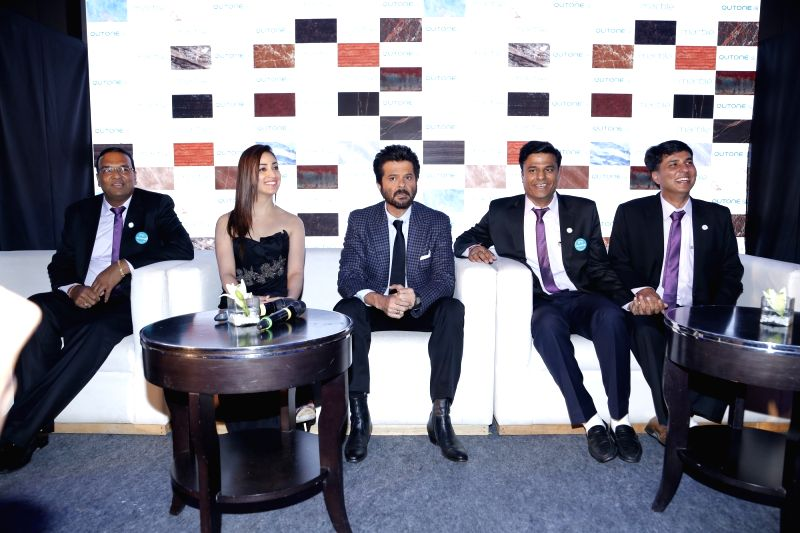Actors Anil Kapoor and Yami Gautam during the launch of a product in Gurgaon on May 14, 2016. - Anil Kapoor and Yami Gautam