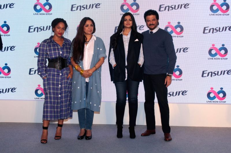 Actors Anil Kapoor, Neena Gupta with producer Rhea Kapoor and Masaba Gupta during a programme in Mumbai on April 25, 2017. - Anil Kapoor, Neena Gupta and Masaba Gupta