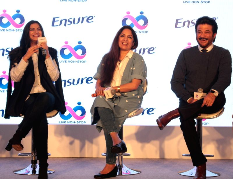 Actors Anil Kapoor, Neena Gupta with producer Rhea Kapoor during a programme in Mumbai on April 25, 2017. - Anil Kapoor and Neena Gupta