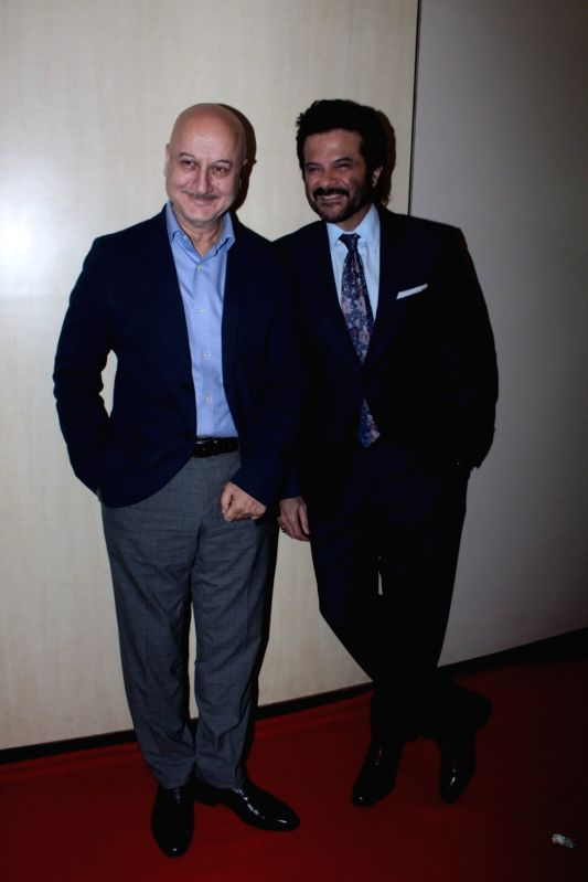 Actors Anupam Kher and Anil Kapoor during the Dada Saheb Phalke Academy Awards 2017 in Mumbai on June 1, 2017. - Anupam Kher and Anil Kapoor