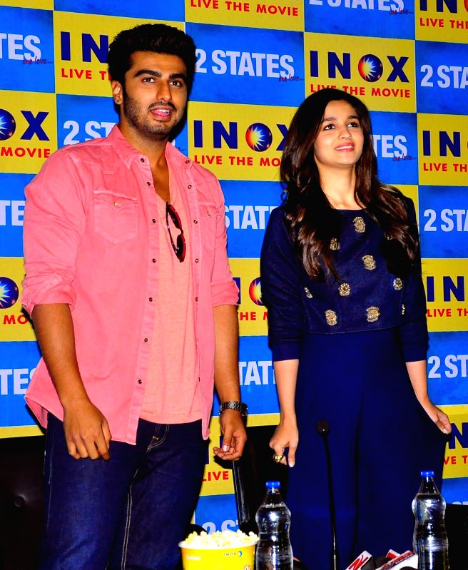 Actors Arjun Kapoor and Alia Bhatt during a press conference to promote their upcoming film '2 States' in Jaipur on April 14, 2014. - Arjun Kapoor and Alia Bhatt