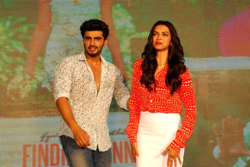 Actors Arjun Kapoor and Deepika Padukone during the launch of song Shake your Bootiya from the film Finding Fanny in Mumbai, on Aug. 22, 2014. - Arjun Kapoor and Deepika Padukone