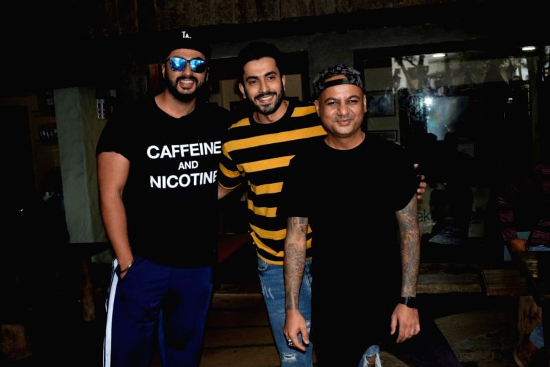 Actors Arjun Kapoor and Sunny Nijar seen at a salon in Versova, Mumbai on Aug 9, 2018. - Arjun Kapoor and Sunny Nijar