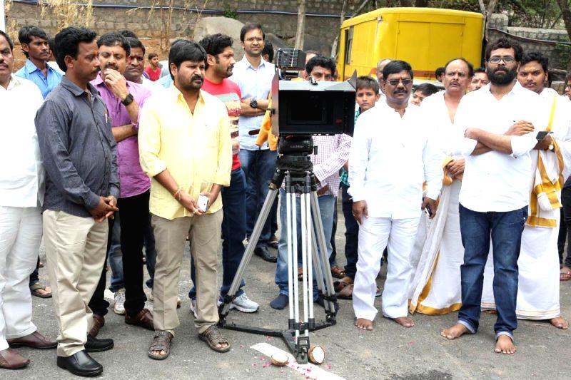 Actors Arjun Yajes, Mouryani during the muhurath shot of their new film under Pattikonda Cinemas banner in Hyderabad on July 12, 2014. - Arjun Yajes and Mouryani