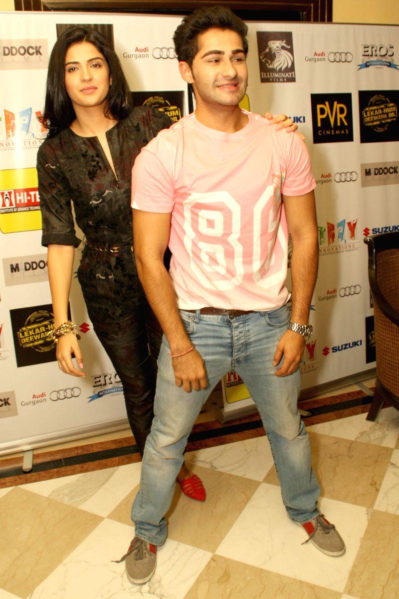 Actors Armaan Jain and Deeksha Seth during a press conference to promote their upcoming film `Lekar Hum Deewana Dil` in New Delhi on July 1, 2014. - Armaan Jain and Deeksha Seth