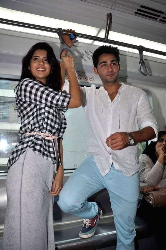 Actors Armaan Jain and Deeksha Seth take a ride in the newly launch Mumbai Metro train during the promotion of the upcoming film Lekar Hum Deewana Dil in Mumbai on June 20, 2014. - Armaan Jain and Deeksha Seth