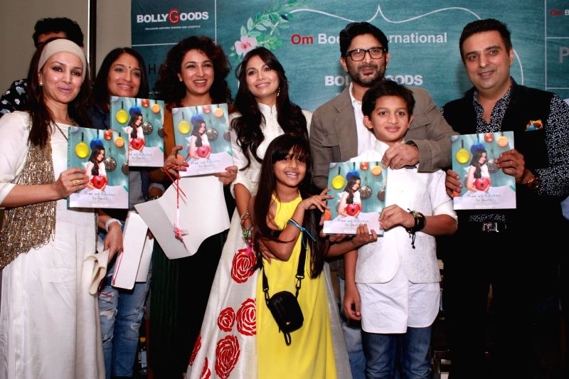 Actors Arshad Warsi with wife Maria Goretti, Sandhya Mridul and Tisca Chopra at the launch of Maria Goretti`s book `From My Kitchen` in New Delhi on Nov 15, 2015. - Arshad Warsi and Tisca Chopra