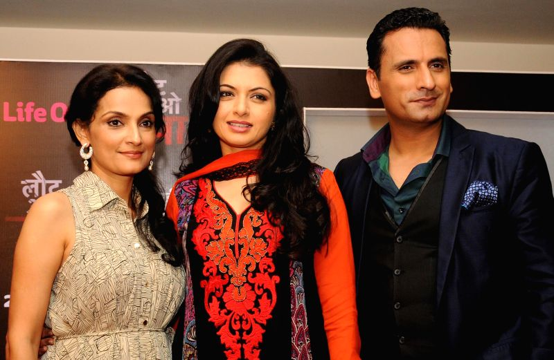 Actors Bhagyashree and Jai Kalra during a press conference to promote their upcoming television soap `Laut Aao Trisha` in New Delhi on July 11, 2014. - Bhagyashree and Jai Kalra