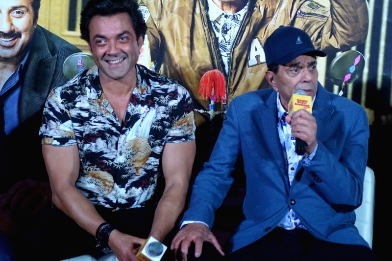 "Actors Bobby Deol and Dharmendra at the trailer launch of their upcoming film ""Yamla Pagla Deewana Phir Se"" in Mumbai on Aug 10, 2018. - Bobby Deol and Dharmendra"