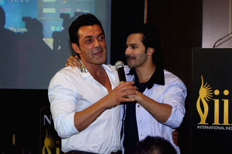 Actors Bobby Deol and Varun Dhawan during a press conference of the 19thEdition of IIFA in Mumbai on June 12, 2018. - Bobby Deol and Varun Dhawan