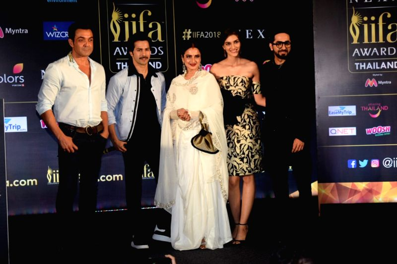 Actors Bobby Deol, Varun Dhawan, Rekha, Kriti Sanon and Ayushmann Khurrana during a press conference of the 19thEdition of IIFA in Mumbai on June 12, 2018. - Bobby Deol, Varun Dhawan, Rekha, Kriti Sanon and Ayushmann Khurrana