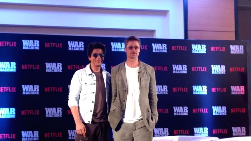 Actors Brad Pitt and Shah Rukh Khan during a programme in Mumbai on May 24, 2017. - Brad Pitt and Shah Rukh Khan