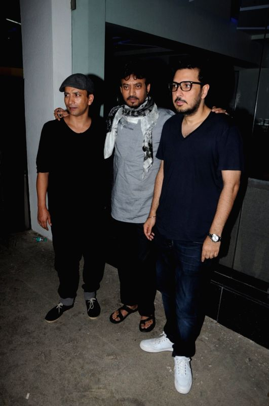 Actors Deepak Dobriyal, Irrfan Khan and filmmaker Nikkhil Advani during the special screening of film Hindi Medium in Mumbai, on May 15, 2017. - Deepak Dobriyal, Irrfan Khan and Nikkhil Advani