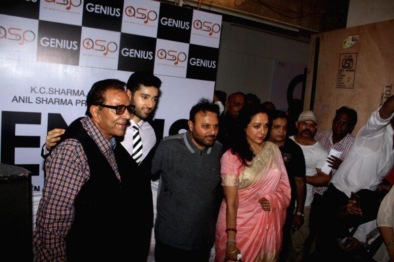 "Actors Dharmendra and Hema Malini with filmmaker Anil Sharma along with his son Utkarsh during the mahurat of film ""Genius"", in Mumbai on May 21, 2017. Utkarsh was previously seen ... - Dharmendra, Hema Malini, Sharma and Ameesha Patel"