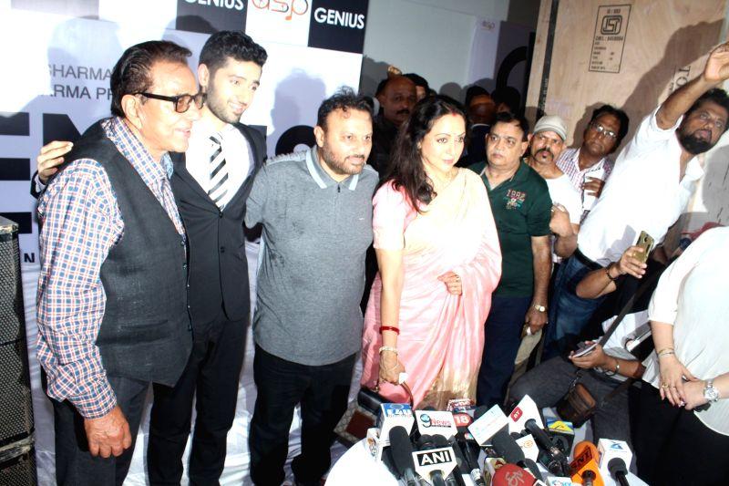"Actors Dharmendra and Hema Malini with filmmaker Anil Sharma along with his son Utkarsh during the mahurat of film ""Genius"", in Mumbai on May 21, 2017. - Dharmendra, Hema Malini and Sharma"