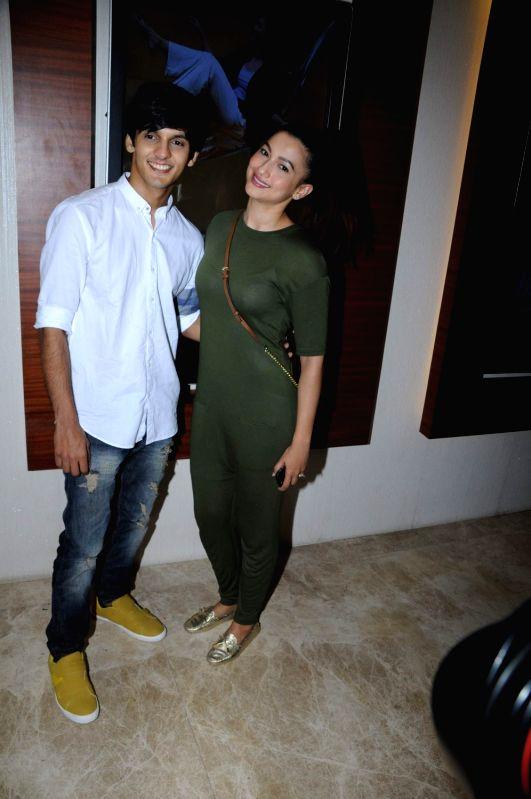 Actors Dhiraj Totlani and Gauhar Khan during the screening of film Peanut Butter in Mumbai on March 6, 2017. - Dhiraj Totlani and Gauhar Khan