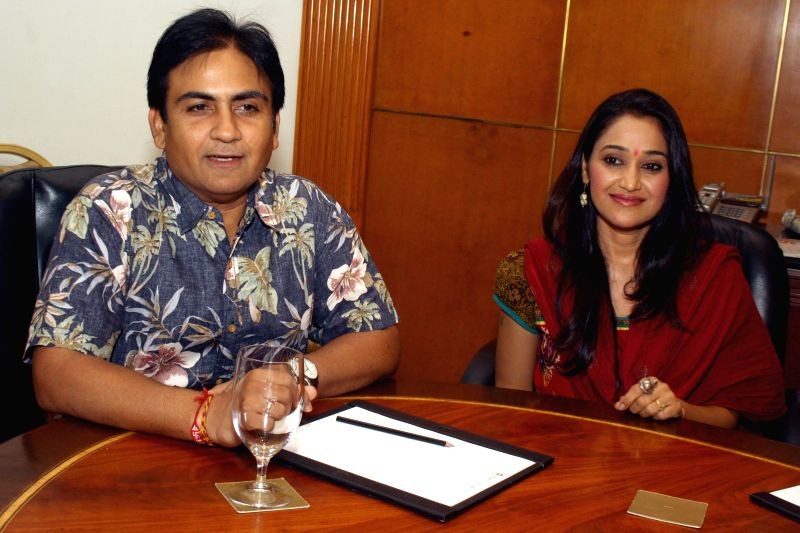 Actors Dilip Joshi and Disha Vakani during a press conference in New Delhi on June 20, 2014.