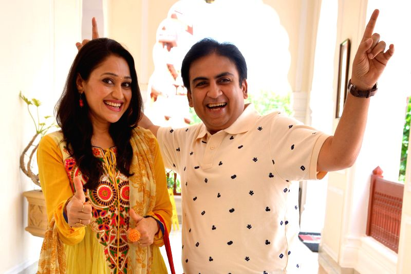 Actors Dilip Joshi and Disha Vakani during a press conference in Jaipur on July 31, 2014.