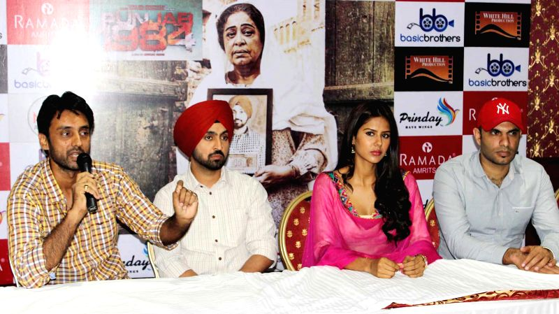 Actors Diljit Dosanjh and Sonam Bajwa during a press conference to promote their upcoming film 'Punjab 1984' in Amritsar on June 22, 2014. - Diljit Dosanjh and Sonam Bajwa