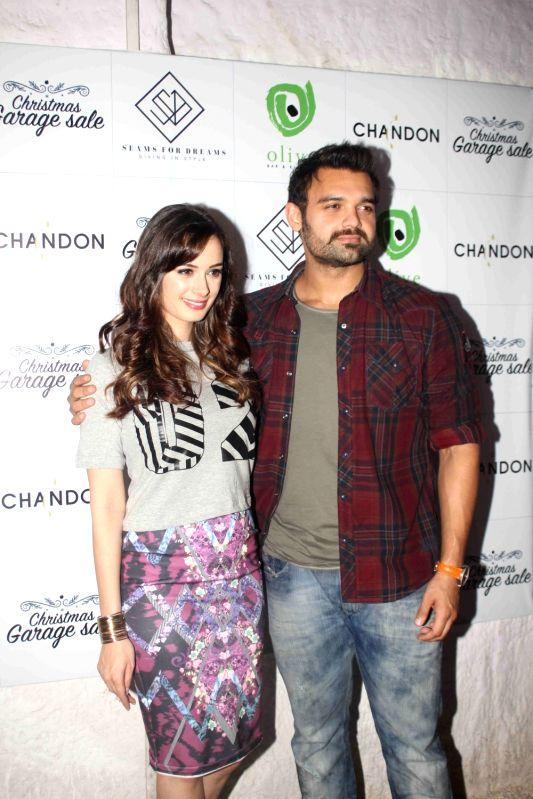 Actors Evelyn Sharma and Mahaakshay Chakraborty during the Christmas fun garage sale in Mumbai on Dec 6, 2015. - Mahaakshay Chakraborty