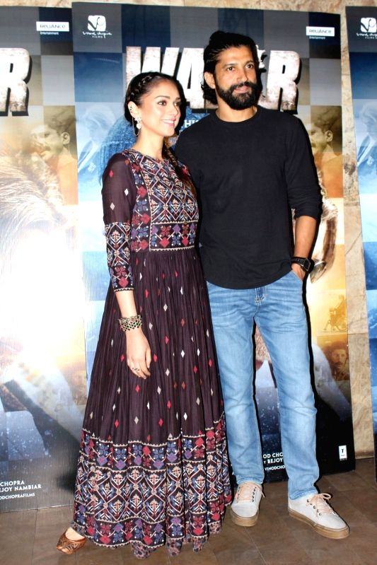 Actors Farhan Akhtar and Aditi Roy arrives to watch the first song Tere Bin from film Wazir in Mumbai on Dec 4, 2015. - Farhan Akhtar and Aditi Roy
