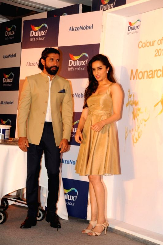 Actors Farhan Akhtar and Shraddha Kapoor during the unveiling of AkzoNobel`s Monarch Gold as Colour of the Year 2016 in a Colour Walk in Mumbai on Dec. 2, 2015.