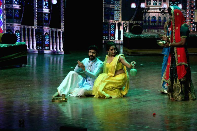 "Actors Gaurav Chopra and Sukhada Khandkekar perform at the premier of their play ""Devdas"" at the Jamshed Bhabha Theatre in Mumbai on Nov 17, 2018. - Gaurav Chopra and Sukhada Khandkekar"