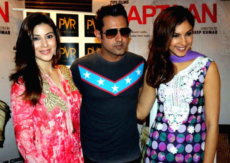 """Actors Gippy Grewal, Karishma Kotak and Monica Gill during a press conference to promote their upcoming film """"Kaptaan"""" in New Delhi on May 14, 2016. - Gippy Grewal, Karishma Kotak and Monica Gill"""