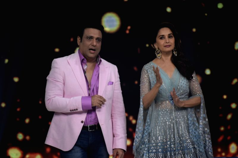 "Actors Govinda and Madhuri Dixit on the sets of reality television show ""Dance Deewane"" in Mumbai, on June 13, 2018. - Govinda and Madhuri Dixit"