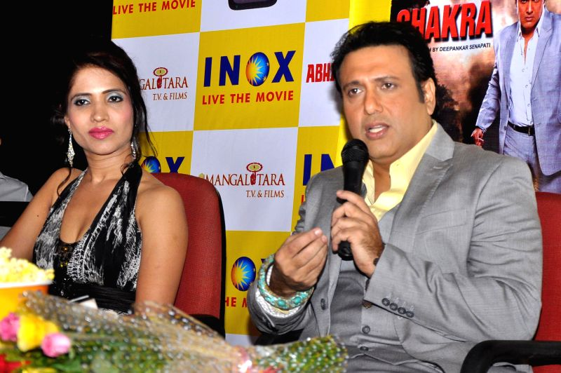 Actors Govinda and Richa Sharma during a press conference to promote their upcoming film 'Abhinay Chakra' in Jaipur on June 18, 2014. - Govinda and Richa Sharma