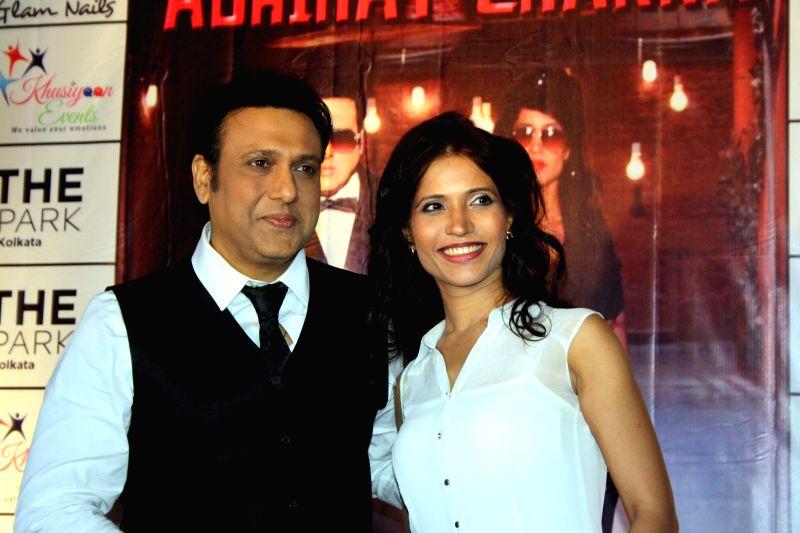 Actors Govinda and Richa Sharma during a press conference to promote their upcoming film `Abhinay Chakra` in Kolkata on July 4, 2014. - Govinda and Richa Sharma