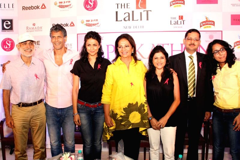 Actors Gul Panag and Milind Soman during a press conference to launch 2nd Pinkathon 2014 in New Delhi on July 31, 2014. - Gul Panag and Milind Soman