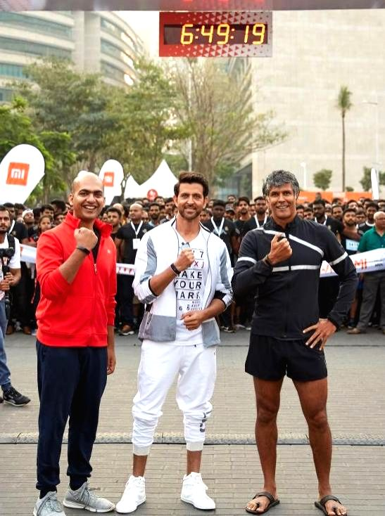 Actors Hrithik Roshan and Milind Soman with Xiaomi India Managing Director Manu Jain during a marathon in Bengaluru, on March 31, 2018. - Hrithik Roshan, Milind Soman and Manu Jain