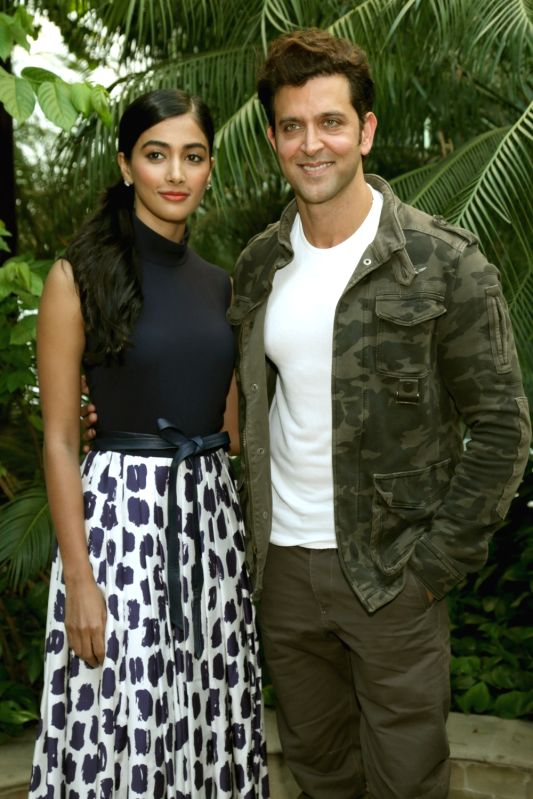 "Actors Hrithik Roshan and Pooja Hegde during a press conference regarding their upcoming film ""Mohenjo Daro"" in New Delhi, on Aug 4, 2016. - Hrithik Roshan and Pooja Hegde"