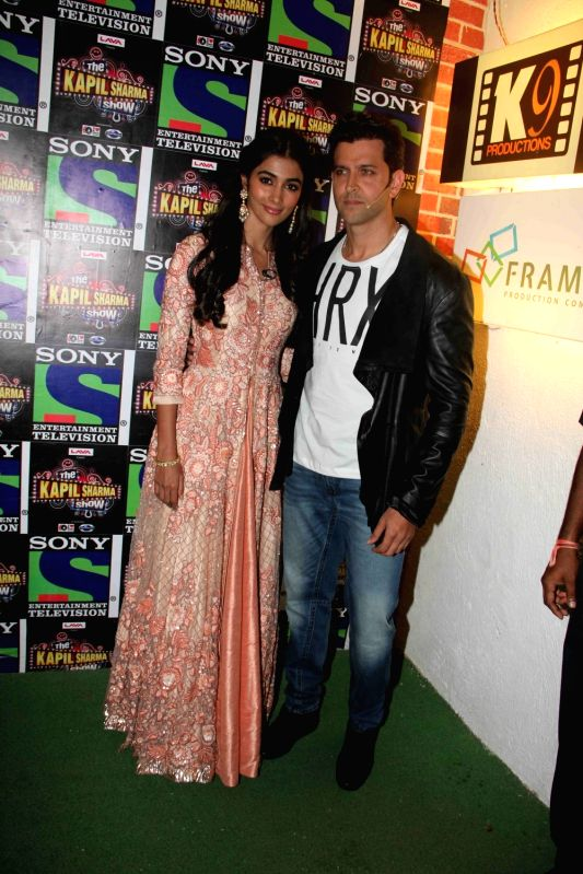 Actors Hrithik Roshan and Pooja Hegde during the promotion of film Mohenjo Daro on the sets of The Kapil Sharma Show in Mumbai, on Aug 2, 2016. - Hrithik Roshan and Pooja Hegde