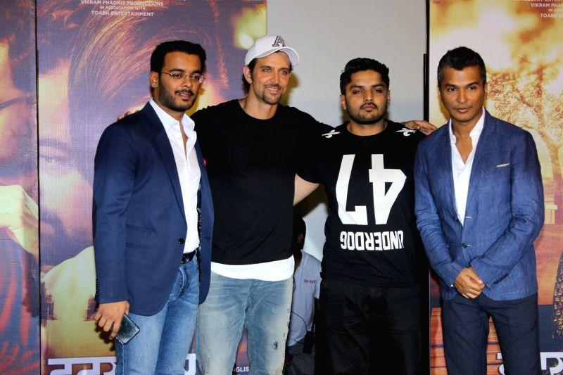 Actors Hrithik Roshan, Mustafa Burmawalla and fashion designer Vikram Phadnis during the trailer launch of Marathi film Hrudayantar in Mumbai on May 28, 2017. - Hrithik Roshan and Mustafa Burmawalla