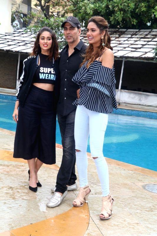 Actors Ileana D`Cruz, Akshay Kumar and Esha Gupta during a photo shoot, in Mumbai, on Aug 1, 2016. - Ileana D, Akshay Kumar and Esha Gupta