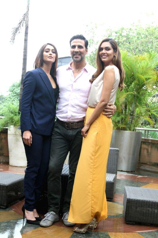 Actors Ileana D`Cruz, Akshay Kumar and Esha Gupta during the media interaction of film Rustom in Mumbai, India on August 6, 2016. - Ileana D, Akshay Kumar and Esha Gupta