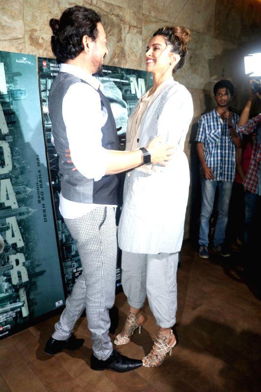 Actors Irrfan Khan and Deepika Padukone during the screening of film Madaari in Mumbai, on July 21, 2016. - Irrfan Khan and Deepika Padukone