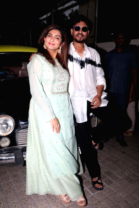 "Actors Irrfan Khan and Parvathy arrive at the trailer launch of their upcoming film ""Qarib Qarib Singlle"" in Mumbai, on Oct 6, 2017. - Irrfan Khan and Parvathy"