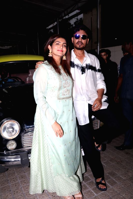 """Actors Irrfan Khan and Parvathy arrive at the trailer launch of their upcoming film """"Qarib Qarib Singlle"""" in Mumbai, on Oct 6, 2017. - Irrfan Khan and Parvathy"""