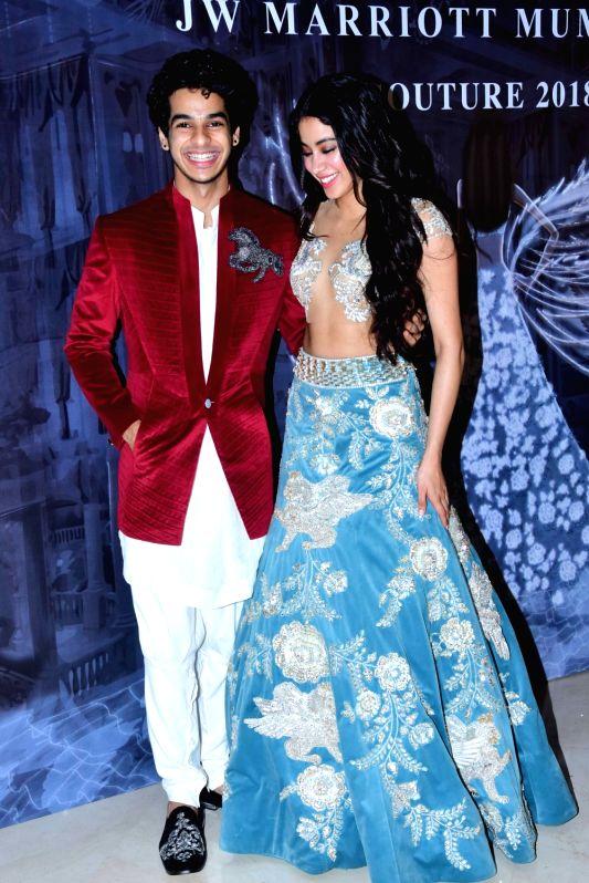 Actors Ishaan Khatter and Janhvi Kapoor at the fashion designer Manish Malhotra's Haute Couture 2018 in Mumbai. - Ishaan Khatter, Janhvi Kapoor and Manish Malhotra