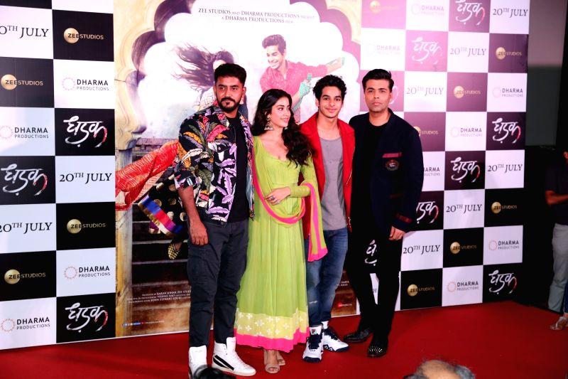 "Actors Janhvi Kapoor and Ishaan Khatter, director Shashank Khaitan and producer Karan Johar at the trailer launch of their upcoming film ""Dhadak"" in Mumbai on June 11, 2018. - Shashank Khaitan, Janhvi Kapoor, Ishaan Khatter and Karan Johar"
