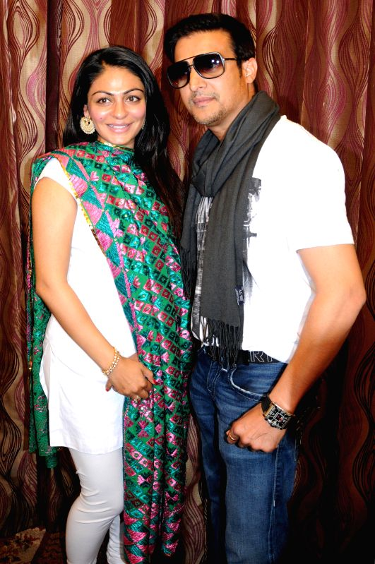 Actors Jimmy Shergill and Neeru Bajwa during a press conference to promote their upcoming film `Aa Gaye Munde U.K. De` in Amritsar on Aug 3, 2014. - Jimmy Shergill and Neeru Bajwa