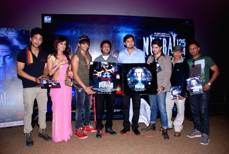 Actors Joey Debroy, Vedita Pratap Singh, filmmaker Hemant Madhukar, Karanvir Bohra and Vije Bhatia during the music launch and first look trailer of horror film Mumbai 125 KM, in Mumbai, on Aug. 21, . - Joey Debroy and Vedita Pratap Singh