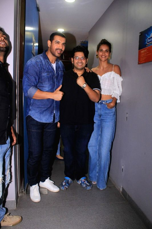 "Actors John Abraham, Aisha Sharma and director Milap Zaveri during the promotion of their upcoming film ""Satyameva Jayate"" in Mumbai on July 13, 2018. - Milap Zaveri, John Abraham and Aisha Sharma"