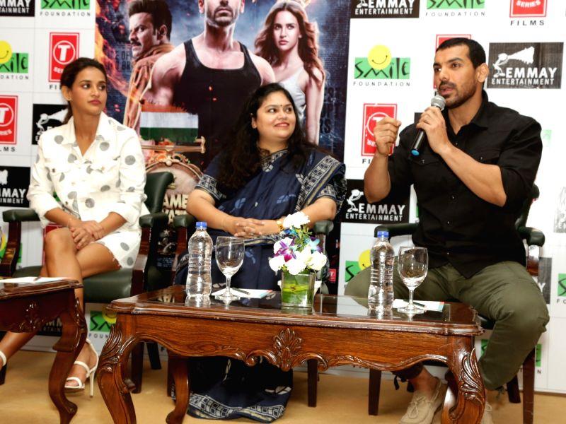 "Actors John Abraham and Aisha Sharma during a press meet to promote their upcoming film ""Satyameva Jayate"" in New Delhi on Aug 10, 2018. - John Abraham and Aisha Sharma"