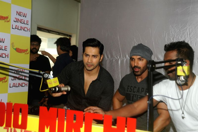 Actors John Abraham and Varun Dhawan during the promotion of film Dishoom at Radio Mirchi studio in Mumbai,July 18, 2016. - John Abraham and Varun Dhawan